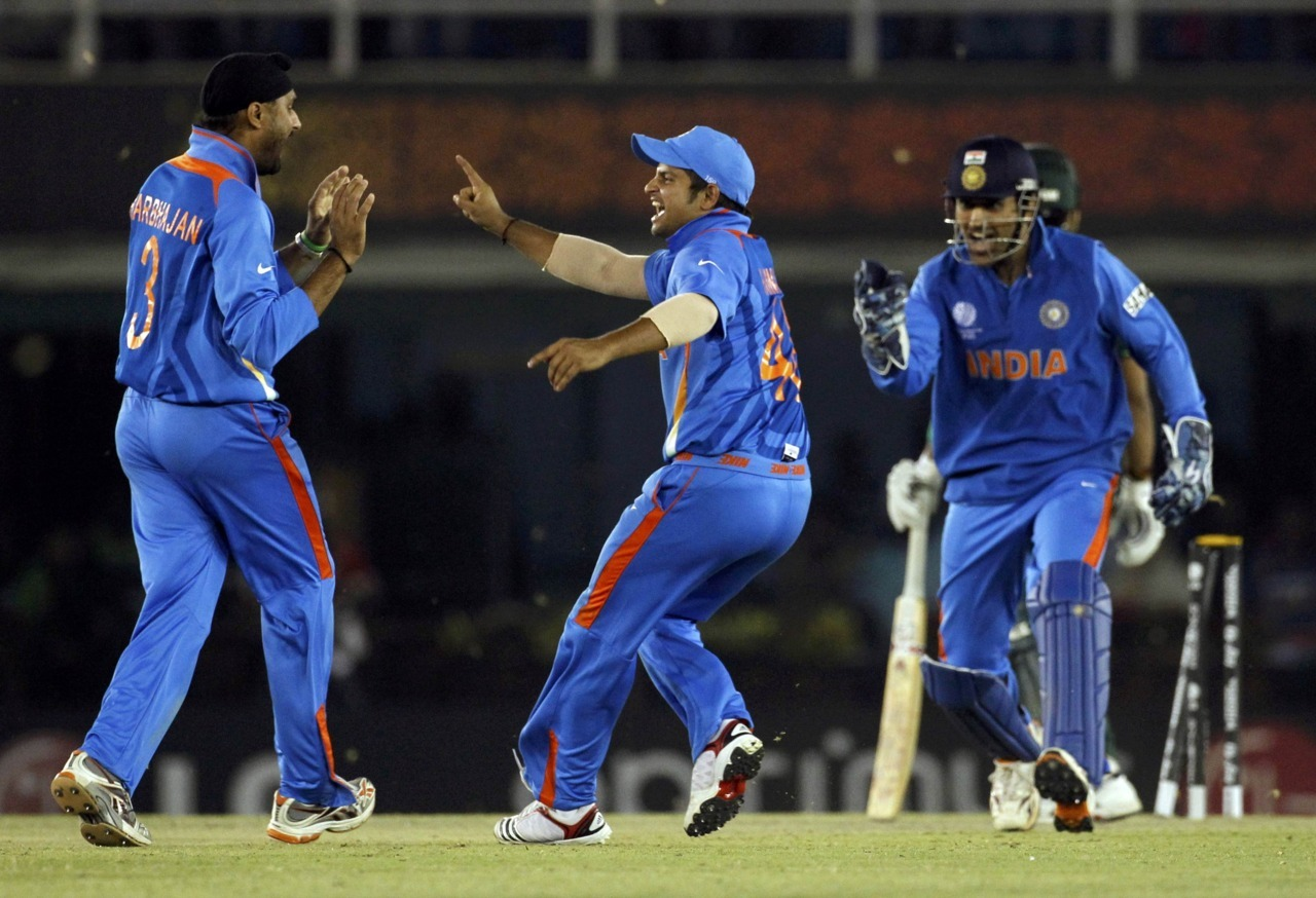 India races to big lead over Pakistan at cricket's World CupSachin Tendulkar's chancy 85 powered India to 260-9 against a Pakistan side which seemed overwhelmed by the hype built around Wednesday's World Cup semi-final and the 'cricket diplomacy' surrounding it.Sitting in the VIP box, Indian Prime Minister Manmohan Singh and his Pakistani counterpart Yusuf Raza Gilani watched on as Tendulkar enjoyed a series of let-offs.Photo: India's Harbhajan Singh is congratulated by Suresh Raina and captain and wicketkeeper Mahendra Singh Dhoni (L-R) after taking the wicket of Pakistan's Umar Akmal during their ICC Cricket World Cup 2011 semi-final match in Mohali March 30, 2011. (REUTERS/Vivek Prakash)