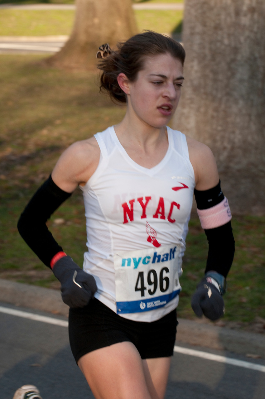 "In honor of Sally: NYC Half 3/20/2011; PR and top 10 American female. I'll look for a better picture of the pink armband and leopard ribbons, but regardless, felt like Sal was there in NYC along with us. She became an honorary member of the NYRR this past year, and a lot of folks in NYC will miss seeing her pink socks and red pigtails go flashing by. I still remember the first time I met Sally, when she showed up to Wallace Wade dressed up in a shirt that looked like it had a boa attached.  She proceeded to teach me that you ""always wear your cutest stuff on a plane, so it doesn't get all wrinkled.""  I still remember that advice…and still have that image of her with her ""boa,"" that redheaded spark in all of our lives."