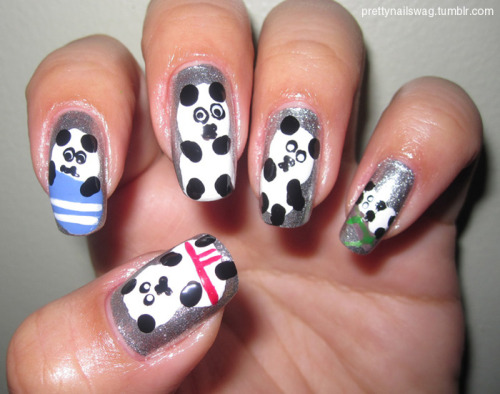 My Panda Nails!!! Did these watching the amaazzzing IHaveACupcake's youtube tutorial here. Not as nice as hers but it's all gravy baby… Used LA Colors Metallic Silver for base and random nail art pens for the other colours and of course 2 coats of Seche Vite Topcoat.