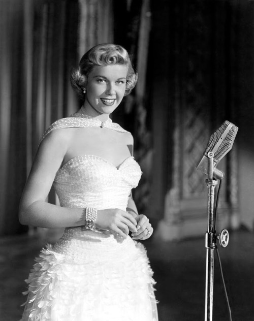 (via Stirred, Straight Up, with a Twist: The Good Girls Wear White) Doris Day…and microphone…