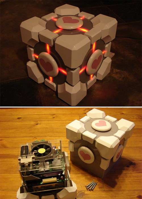 gamefreaksnz:  Weighted Companion Cube casemod Here's a  detailed thread on how it was made.  This may very well be my new favorite thing.
