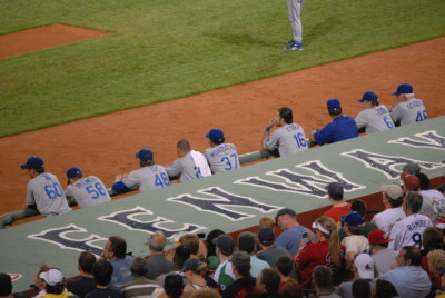 "The Boys in Blue at Fenway, Summer 2010. Today is opening day at Dodger Stadium and I'm feeling a little homesick. I wish I could teleport to Chavez Ravine for some good old-fashioned rooting for the boys in blue. The deeper part of being homesick and thinking about the Dodgers is missing my Dad. This is a short piece I wrote around this time last year in my nonfiction writing class.  It was a quick assignment, so it's pretty rough around the edges.  But, the writing is just as true today as it was last year. —- Bleeding BlueIt's my favorite time of year right now.  It's the time for hot dogs, garlic fries, and frozen lemonade.  It's the time of year when the field is a dark and light green chess board with an edge of burnt red dirt.  It's the time of year when Vin Scully's voice is sweet music to my ears.  It's the time of year to sing and do a seventh-inning stretch.  It's the time of year when I don't leave until the game is over and they play ""I Love LA.""  It's baseball season and I am a Dodgers fan.My love for the Dodgers is as much a part of me as my Japanese heritage, my love for photography, and my very DNA.  Like many things in my life, there is a back story to my love.  On the surface, I was born and raised in Pasadena, a suburb in Los Angeles County and a short 20 minutes away from Dodger Stadium.  They were my home team by the mere fact of simple geography.  My parents are Dodger's fans.  My dad has a fly ball he had caught at a game and later had signed by Dusty Baker.  One of my parent's first dates was to a Dodgers game, which was my Mom's first Major League Baseball game.  Both of my older brothers played little league and collected basbeball cards.  I distinctly remember going to games as a family when I was younger.  My father's love for the Dodgers came from his father, who still watches Dodger games or listens on the radio while he wears his blue member's only jacket.  My grandpa loves the Dodgers and sat in the field box with sports photographers, snapping photos of the boys in blue.When I decided to pack my bags and head East for college, my father told me one thing, ""If you become a Red Sox fan, I'll disown you.""  I know my Dad joking, but at the same time, there's a part of him that means it.  For our family, the Dodgers are part of the glue that holds us together.  Like faith, and tradition, and love, the Dodgers are another facet of my family.This is my favorite time of year.  It's the time of year when it's okay to match my family because we're all wearing blue.  It's the time of year when I'll sit on the back porch with my Dad listening to the the crack of a ball and bat transmitted over radio waves and into the cool evening air.  It's the time of year when I will stand up screaming alongside my brother's when the Dodgers are beating the Giants.  It's the time of year to know my blood runs royal blue just like the rest of my family."