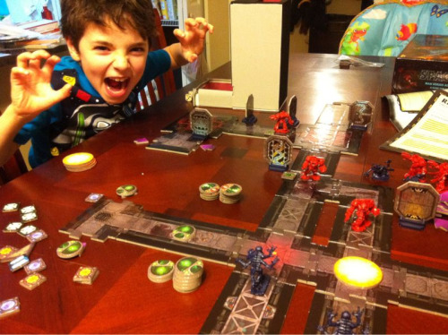 Game Night - Space Hulk  As you can probably tell, he loved it. I had no plans to introduce this game to him (he's pretty fragile at times), but he insisted the box images and pieces didn't scare him. His only request was that I didn't make Wilhelm-scream sounds when the space marines were eaten. We played easy and learned the game together - it was brilliant. And when you combine this ending with the fact that I walked into a game store up the highway and nearly stubbed my toe on a copy of War of the Ring (my presssssscious…) this morning?!?!? — This may qualify for best game day ever. EVER.