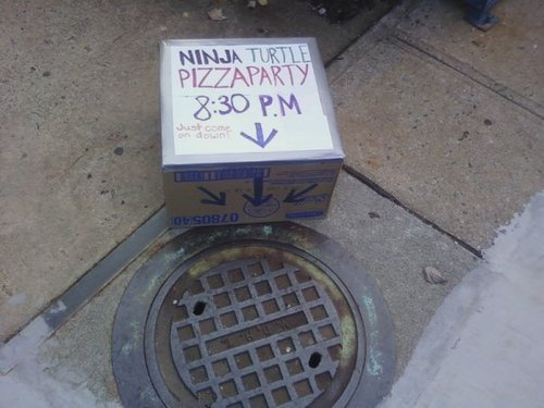 "PHOTO: Sitting next to a manhole cover is a box that reads, ""Ninja Turtle Pizza Party, 8:30 P.M. Just come on down."" THANKS I THINK I WILL! (This is not creepy AT ALL.)"