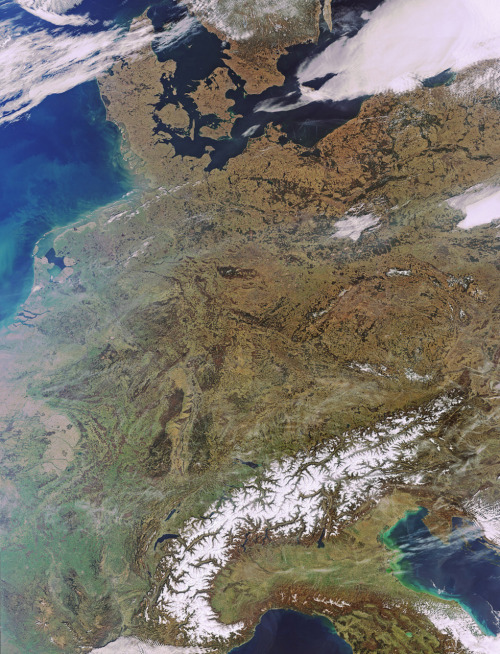 Earth from Space: Central Europe  This Envisat image, acquired on 22 March 2011, features an almost cloud-free look at a large portion of Europe. The Alps, with its white peaks, stand out in contrast against the vast areas still covered in brownish winter foliage. Several dark blue European lakes also stand out. The crescent-shaped Lake Geneva (north of Alps) is Europe's largest Alpine lake. Its northern part is located in Switzerland, and its southern part in France. With a surface of 218 sq km, Lake Neuchâtel (above Lake Geneva) is the largest lake located entirely in Switzerland. Lake Constance (northeast of Lake Neuchâtel) straddles the borders of Austria, Germany and Switzerland. Italy's largest and Central Europe's third largest lake, Garda, sits at the foot of the Alps. (via ESA)