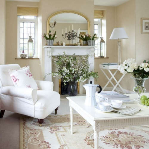This is the design theme of the living room with a classic atmosphere. The dominant white color makes the atmosphere comfortable and cool. Cream, white and red soft furnishings along with lush green foliage gives this living room country feel. A rose-print pillow cover echoes the delicate flower show fun.