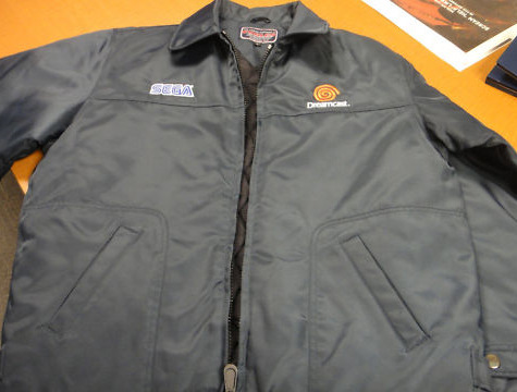 Auction: Dreamcast Employee Jacket Sega of America has shown no shortage of generosity with its auctions during the Play For Japan campaign, and it's in items like this that it's even more apparent. Witness this: a Dreamcast Employee Jacket from the late 90s.When you finish drooling about how awesome this item is, we've got info below to tell you even more about it!First, this is a super-rare, Employees only Dreamcast jacket that was given out to the original Dreamcast team here at SEGA of America right around the original launch. This jacket in particular is brand new, having never been worn and still has the original tags around the zipper from the manufacturer. It's a size L, and features a fully embroidered SEGA Logo on the left, and a fully embroidered Dreamcast logo on the right.This is one of our most amazing pieces of Dreamcast merchandise to hit the auction block. Not only is this an insanely rare jacket on its own, but it's also still in completely new condition, now over ten years later. If you're a Dreamcast fan, this is a rare opportunity to pick up a piece of merchandise even most of us here at SEGA will never have a chance to own – and all for a good cause!Your chance to win this exceptionally rare item will expire on April 6 at 19:39:58 PDT. All of the sales proceeds from this auction benefit the American Red Cross.