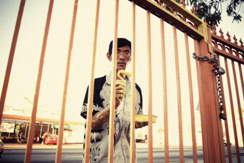 Peter Eng paints a gate at the Wat Khmer Temple in the Westlake district of Los Angeles.
