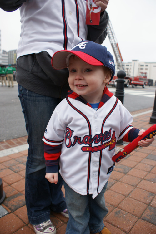 TinyTot, Katie and I had the best time at the Braves game yesterday. They beat the Nationals 2-0. It was cold and rainy but after buying the little one a second sweatshirt everything was alright. I dealt with the cold like a champ. We also got our first baseball of the season, a BP ball that was hit down the line near where we were standing before the game. I dove over the railing and used my hat to get it.