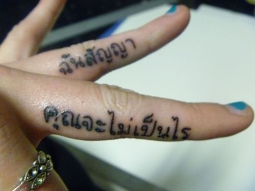 "fuckyeahtattoos:  It says ""you'll be okay"", ""promise"" in Thai."