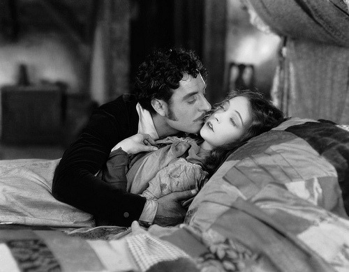 John Gilbert and Lillian Gish (1893 - 1993) in a scene from the film 'La Boheme' (1926) directed by King Vidor for MGM.