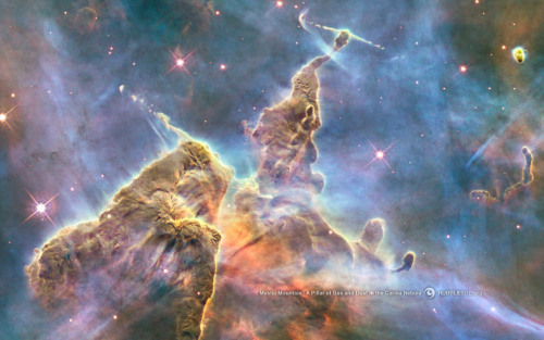 This is a real photograph of a massive pillar of gas and dust in the Carina Nebula.
