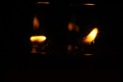 taking pictures of candles in the dark. I've got some better exposed ones but I liked this because of that texture.