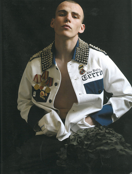 Zoo Magazine The modern military man, studded and bejewelled. A true sight of terror, an audacious street commander and a brazen dictator in whatever he does. Considering that most people living in the developed do not fight battles in its more standard definition, the only war left is in art and science.