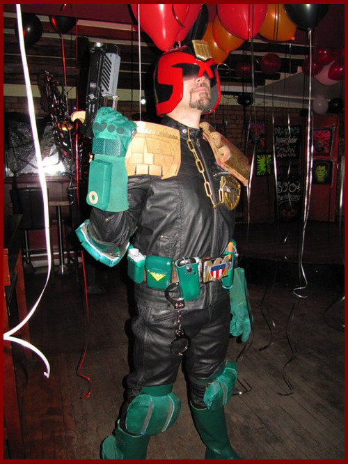 Another internet photo find of me in full Judge Dredd cosplay - Halloween 2010.  Really must put this sucker back on sometime soon and go out Judgin' again..!  Photographer unknown.