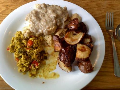 prettypeopleneverlie:  Tofu scramble, encore potatoes, and vegan biscuits and gravy. Finally had Sunday brunch at Bfoods today after not having it for >6 weeks! Then I have a vegan philly cheesesteak with french fries for dinner at the Owlery which also ruled! Then Gnat and I got ice cream and ate that. Post race reward day ftw.