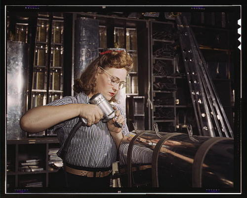 coolchicksfromhistory:  [a] woman is working in the control surface department assembling a section of the leading edge for the horizontal stabilizer of a plane, Inglewood, Calif. 1942