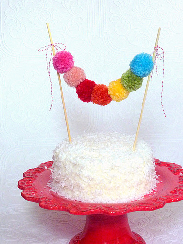 daintyloops:  Yarn Pom Cake Garland by Shortcake Party Shop (by shortcake party shop)