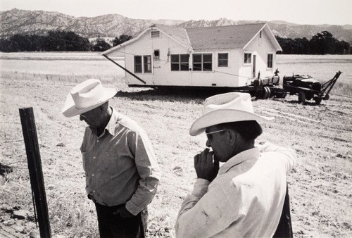 "The art: Pirkle Jones, House Being Moved, from the series ""Death of a Valley,"" 1956 (printed 1960). Jones and Dorothea Lange collaborated on ""Death of a Valley,"" which chronicled the last days of Monticello, Calif., before the town and the surrounding Berryessa Valley were dammed into Lake Berryessa. The reservoir is sited west of Sacramento, about halfway between the state capital and the Napa Valley wine-growing region. It's one of the least-known great narrative photo-documentary series in American art. The news: ""Water, water everywhere, but not enough is saved,"" by George Skelton in the Los Angeles Times. Skelton reports that California built its last dam in 1979. Since then the state's population has increased by about 50 percent, or over 14 million people. The source: Collection of the San Francisco Museum of Modern Art. More of the series is online here."