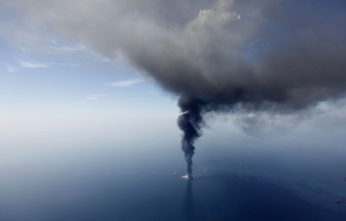 "The BP oil rig Deepwater Horizon burns in the Gulf of Mexico in April, 2010.  Now, on the eve of the one-year anniversary of that horrific environmental disaster — which also killed 11 of BP's own workers — guess who wants to start drilling again?  From The Washington Post:  BP is in talks with the Interior Department about permits that would allow it to resume deep-water drilling in the  Gulf of Mexico, according to two sources familiar with the discussions.  The company hopes that it can restart several projects sometime this  summer. The discussions come just before the anniversary of the April 20  blowout on the Deep­water Horizon rig that BP leased for an exploration  well called Macondo. The blowout killed 11 workers, set the rig on fire  and triggereda huge oil spill that gushed for 87 days. BP  hopes to ultimately obtain permission to begin drilling about 10 wells  to boost output in fields that are already producing oil; none of them  would be an exploration well, one of the sources said. No work would be  done in the near future on the field discovered by the Macondo well. Discussions with Interior's Bureau of Ocean Energy Management, Regulation and Enforcement (BOEMRE) about other BP wells are still underway, focusing on BP's safety  program. Melissa Schwartz, a spokeswoman for the agency, said that  BOEMRE Director Michael R. Bromwich meets regularly with companies to  discuss their operations and that ""BP is no different.""  (Photo: Gerald Herbert / AP via The Washington Post)"
