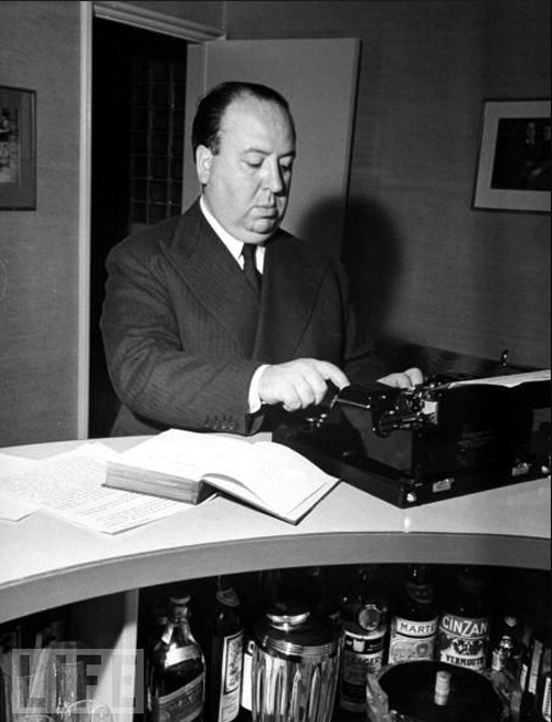 Alfred Hitchcock, his typerwriter and a finely stocked bar. Click for our gallery of more authors + typerwriters.