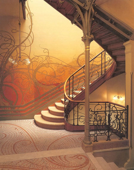Beautiful whiplike vines climbing the wall. (via Quick History: Art Nouveau | Apartment Therapy New York)