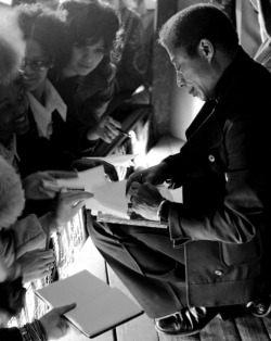 "tayarijones:  tatteredcover:  Autographing books allthingsjamesbaldwin:  Author James Baldwin in Germany, 1972  James Baldwin, civil rights activist and author of such works as ""Go Tell It on the Mountain,"" ""The Fire Next Time"" and ""Notes of a Native Son,"" signs autographs for young admirers at Ludwigsburg High School. (image credit: Regis Bossu/Stars and Stripes)   Baldwin in Germany. Almost didn't recognize him. I want go back to the days when writers dressed like this…"