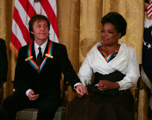 With Oprah Winfrey during the 2010 Kennedy Center Honorees reception in the East Room of the White House on December 5, 2010 in Washington, DC.