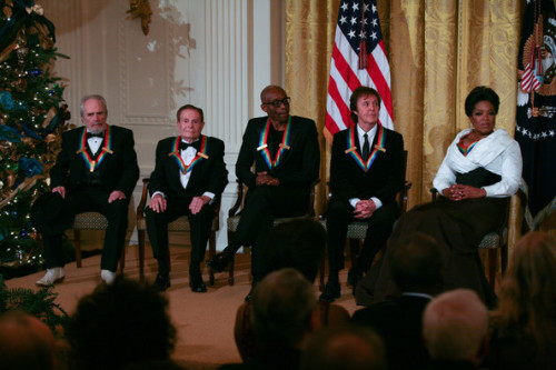 With Barack Obama, Merle Haggard, Jerry Herman, Bill T. Jones and Oprah Winfrey during the 2010 Kennedy Center Honorees reception in the East Room of the White House on December 5, 2010 in Washington, DC.