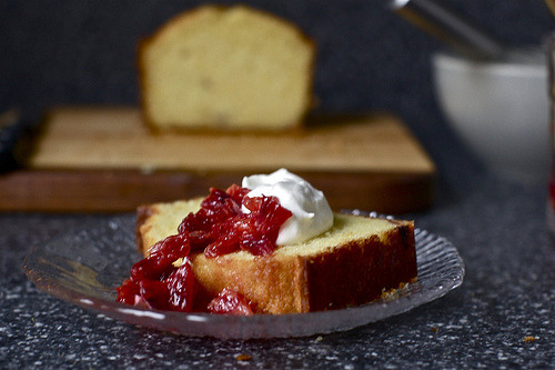 Blood Orange Olive Oil CakeAdapted from A Good Appetite Butter for greasing pan3 blood oranges1 cup (200 grams or 7 ounces) sugarScant 1/2 cup (118 ml) buttermilk or plain yogurt3 large eggs2/3 cup (156 ml) extra virgin olive oil1 3/4 cups (219 grams or 7 3/4 ounces) all-purpose flour1 1/2 teaspoons (8 grams) baking powder1/4 teaspoon baking soda1/4 teaspoon saltHoney-blood orange compote, for serving (optional, below)Whipped cream, for serving (optional) Preheat oven to 350 degrees. Butter a 9-by-5-inch loaf pan. Grate zest from 2 oranges and place in a bowl with sugar. Using your fingers, rub ingredients together until orange zest is evenly distributed in sugar. Supreme an orange: Cut off bottom and top so fruit is exposed and orange can stand upright on a cutting board. Cut away peel and pith, following curve of fruit with your knife. Cut orange segments out of their connective membranes and let them fall into a bowl. Repeat with another orange. Break up segments with your fingers to about 1/4-inch pieces. Halve remaining orange and squeeze juice into a measuring cup; you'll will have about 1/4 cup. Add buttermilk or yogurt to juice until you have 2/3 cup liquid altogether. Pour mixture into bowl with sugar and whisk well. Whisk in eggs and olive oil. In another bowl, whisk together flour, baking powder, baking soda and salt. Gently stir dry ingredients into wet ones. Fold in pieces of orange segments. Pour batter into prepared pan. Bake cake for 50 to 55 minutes, or until it is golden and a knife inserted into center comes out clean. Cool on a rack for 5 minutes, then unmold and cool to room temperature right-side up. Serve with whipped cream and honey-blood orange compote (below), if desired. Honey-Blood Orange Compote: Supreme 3 more blood oranges according to directions above. Drizzle in 1 to 2 teaspoons honey. Let sit for 5 minutes, then stir gently.