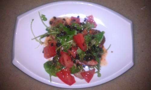 grilled duck breast, watercress, blood orange vinaigrette, fried capers