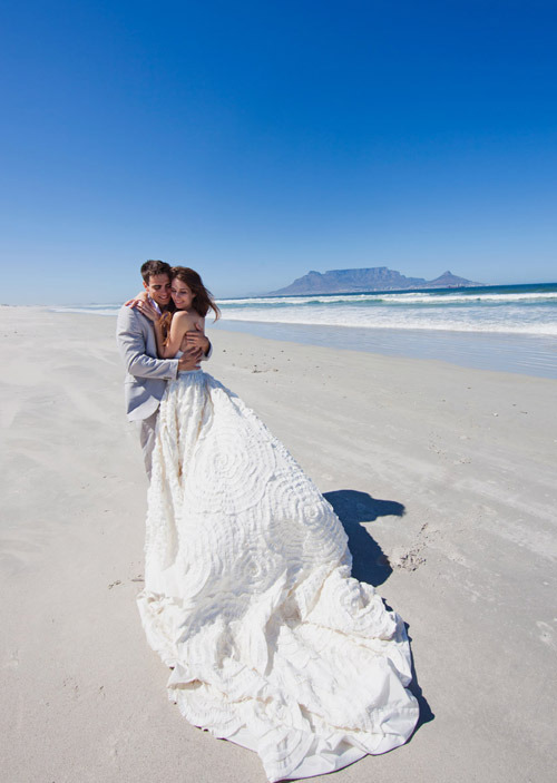wedspace:  Ohh, the dress, the seascape, just incredible … {shot by Rensche Mari, via Junebug Weddings}
