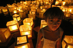 Dal-uy: Festival of Hope Dumaguete City, Philippines  A girl wades amid lighted floats in the waters off Dumaguete City, Philippines. The floats were part of the Dal-Uy Festival of Hope. Participants decorated small plywood and paper craft and inscribed them with their hopes for the future before launching them into the sea.  [via hersley]