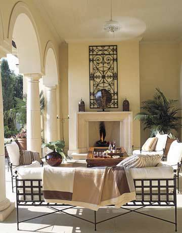 "Take a Mini Vacation at Home Outdoor Room In this outdoor room, ""everything is meant to be a backdrop for the view,"" says the designer, Fern Santini. ""You can see the entire Austin skyline, and a chain of lakes."" Classic iron furniture from Janus et Cie."
