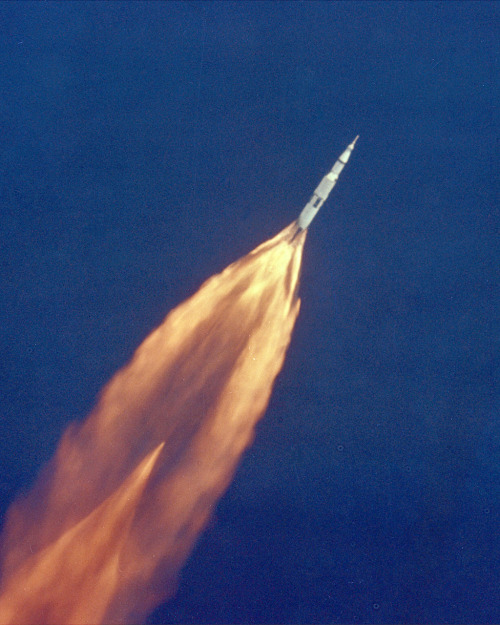 This image of the Apollo 11 launch shows the Saturn V's underexpanded nozzle (identifiable by the excessive width of the exhaust jet) shortly after liftoff. The faint diamond shape of the exhaust is a series of shockwaves and expansion fans that equalize the exhaust pressure to the ambient. In general, a rocket nozzle is most efficient when it expands the exhaust to ambient pressure, but, since ambient pressure changes with altitude, designers have to choose a particular altitude for peak efficiency or design a nozzle capable of changing its shape with altitude.