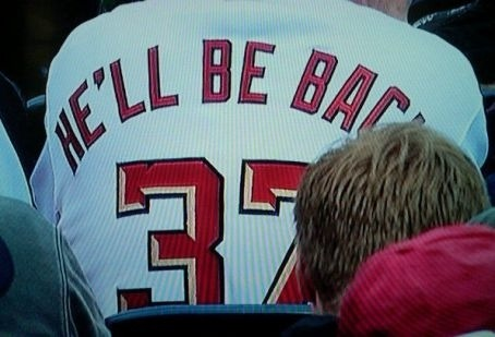 World's Worst Strasburg Jersey Gives Us A Brilliant Idea. Yes, that's a picture of someone who purchased a Stephen Strasburg and used it to broadcast a rather obvious fact.  HOWEVER, this does give me an idea: Interactive jersey messaging.  Your jersey comes equipped with a custom message on the back that you can change AT ANY TIME.  That way, you can update your jersey to QUESTIONABLE once Stephen starts rehabbing that arm. -DM [Dan Steinberg] (Photo: @D_A_Baracus)