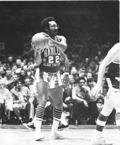 In 1972 the Harlem Globetrotters signed comedy legend Bill Cosby to an honorary $1 lifetime contract.  It's unclear if Bill played more than one game with the Globetrotters, but they raised his salary to a whopping $1.05 in 1986.  Not a bad deal for someone who was a star athlete at Temple University.  More classic Globetrotter photos and your music pairing after the jump. (via Photo: Bill Cosby playing for the Harlem Globetrotters in 1972 | The Strut)