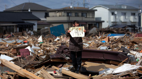 "Red Cross aid hasn't reached Japan quake victims - latimes.com Japan's Red Cross has collected more than $1 billion in the first three weeks after the massive earthquake and tsunami but has yet to distribute any funds directly to victims, prompting Chief Cabinet Secretary Yukio Edano to urge Sunday that the process be accelerated. Meanwhile, the operator of the crippled Fukushima nuclear power plant reported no significant progress in stopping the leak of radioactive water into the sea. Tokyo Electric Power Co. officials think the leak has been coming from a concrete pit holding power cables near reactor No. 2, and attempted Sunday to seal a crack there with a special polymer. Edano said that the government was going to have independent experts retest the air and soil around the power plant and use that information to re-evaluate whether its current evacuation orders should be modified. Currently, the government has told residents living within 12 miles of the plant to evacuate, and has urged those living within 18 miles to leave or at least stay indoors as much as possible. The government has come under renewed pressure from groups including Greenpeace to expand its evacuation area, but at the same time, residents who vacated the 12-mile zone have been seeking permission to return to their homes briefly to gather personal items. Officials in recent days have not shown signs of budging in either direction, and Edano said Sunday the current order will last ""a long time,"" though he conceded it was ""tough on residents."" The chief cabinet secretary added that the government had checked the thyroid function of 900 children up to age 15 in two villages, Iitate and Kawamata, just outside the 18-mile perimeter and none was found to have been exposed to high radiation levels. High levels of radiation have been detected in the water and on grass in Iitate. Edano said it was the third time that the government had conducted tests on children in areas just outside the 18-mile zone. The official death toll from the March 11 disaster topped 12,000 on Sunday as about 25,000 U.S. and Japanese troops finished an intensive three-day effort to recover bodies. The search located 77 corpses, but more than 15,000 people are still officially listed as missing. Another 160,000 people remain in shelters. The Red Cross has dispatched more than 200 emergency relief teams to the disaster zone and organized thousands of volunteers to assist victims. But no displaced people have received cash handouts from the pot of 870 billion yen collected by the Japanese Red Cross and Red Crescent Societies and the Central Community Chest of Japan. In past disasters, independent panels in each prefecture have determined who gets such handouts and how much they get. Edano suggested that this time, the process must be streamlined."" Normally donations are disbursed through local governments that rely on independent committees to decide on the conditions for dividing up the money,"" Edano said. ""But this time, the central government has a role to play in setting up an independent committee"" that will figure out how to split up donations. Tomohide Atsumi, president of the Nippon Volunteer Network Active in Disaster, said the Red Cross has ""a policy of equity and places a high value on equality, and it takes times to assess damages."" In contrast, he said, donations to nonprofit groups often get spent immediately. Atsumi said his organization used funds collected right after the disaster to buy underwear and other supplies for evacuees and charter a bus for volunteers to help victims in northern Japan. Overall, he said, Japan is still learning how to strike the right balance between order and a more free-form approach in its disaster relief efforts. An overemphasis on organization and top-down decision making, he said, probably prevented more volunteers from going to the disaster zone more quickly and doing some good. ""The drive to be organized is very strong in our society… but people are not good at socially improvising,"" he said. ""I like to use the metaphor of classical music vs. jazz. Our traditional disaster response is like classical music — there's a conductor, a big orchestra, a fancy hall. Disaster relief should be more like jazz — you can do something with one trumpeter, one drummer. You don't need a whole orchestra."" As the disaster zone has become more accessible, experts are learning more about the size and force of the massive tsunami. A group of researchers led by Yoshinobu Tsuji of Tokyo University's Earthquake Research Institute has been studying the tsunami-hit area around Miyako, in Iwate prefecture. They found evidence that the waves could have been as high as 124 feet, according to public broadcaster NHK. That would make them the tallest waves to hit Japan's northeastern shore since 1896, when the tsunami waves recorded at Ofunato were 125 feet high. ""This tsunami was comparable to the [1896] tsunami — and it might have been bigger,"" Tsuji said. (via Red Cross aid hasn't reached Japan quake victims - latimes.com) (via internerd:)"