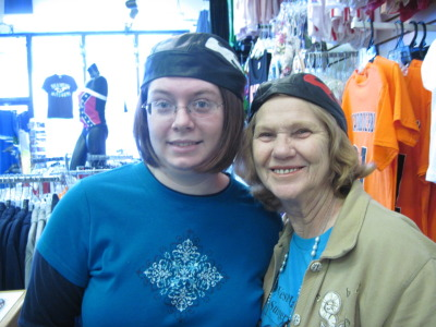 Me and my Aunt Carolyne. We were in Branson, at a shop across W76 from the old Wal-Mart :3 We showed up a little early to go to Wakyoto, so we were just strolling through the different stores. She found these biker caps and, we tried them on. Mom got the shot :) I think we're safe from turning hard core and hitting the road for life…