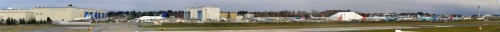 The Boeing Factory (and flight line) at Paine Field in Everett, WA. Click through for hugeass hi-res panoramic awesomeness - Tumblr squished the original :( L to R: The assembly plant, the Dreamlifter (!!! beluga plane ♥); a bunch of 787 Dreamliners, some 747-8s, all without engines. There's a ridiculous number of planes sitting in…well, this parking lot, waiting for flight testing and certification. Cool but sad at the same time. *Panoramic awesomeness brought to you by Hugin, the open source panorama stitcher :) Yay for my first-ever panorama!