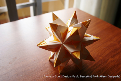 Bascetta Star/ Stellated Icosahedron on Flickr.Via Flickr: Design by Paolo Bascetta Folded by Aileen Desipeda video tutorial by barbabellaatjewww.youtube.com/watch?v=JxkBSAXcfqQ Bam! ^_^ New origami from me! ^_^ Bet you didn't see that coming? :)  I'm just so happy that my internet is now more stable… stable enough for uploading pretty origami.  I have 4 more to show you guys… I really haven't stopped folding, just got lazy uploading.  Anyway, I'm back again for more origami goodness.  :) Try this one for size ^_^
