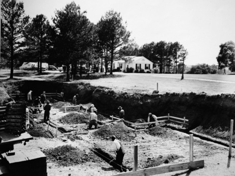 "The foundation for Mamie's Cabin being laid at Augusta National in 1953.   Copy photographed Friday afternoon February 11, 2011.   Photo Courtesy  of Lowrey Stulb. Lowrey Stulb is another behind-the-scenes influence on Augusta National.  If you look closely around the grounds of Augusta National this week,  you'll see several pieces of Stulb's architecture. Along with the  Eisenhower Cabin (also known as ""Ike's Cabin""), Stulb designed the pro  shop. He also designed one of the course's most famous landmarks,  Sarazen Bridge."