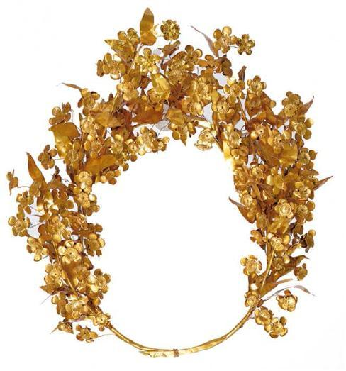 "Meda's wreath from the tomb of Philip IIGold, some 80 leaves and 112 flowers surviving, c. 310 BC, diameter 26 cm""This gold myrtle wreath is amongst the most precious objects found in the antechamber of the tomb of Philip II. It is associated with his wife, the Thracian princess, Meda."""