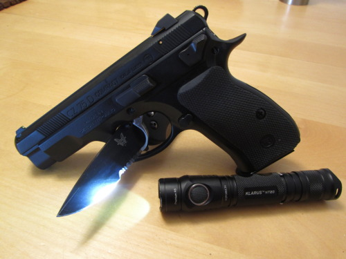 submitted by tactpractedc  Some new items to the pocket family: CZ-75 D Compact 9mm Klarus NT20 2xCR123 light. The Griptilian isn't new, but it has a permanent spot in the jean pocket.  The Klarus is really nice.  Really solid build, the UI is straight forward, and I really dig the side button.  The NT20 has a variable strobe, which is a nice feature, as it seems to add a bit more confusion at the target.  From what I understand, my boss told me that one of the head guys from Fenix left to start Klarus, which I can see in the quality, seeing that we never get returns.  The CZ is just a tank of a gun.  Editor's Note: I'd been wondering about the Klarus line, thanks for the info. Looks like a good tactical setup, hopefully you'll never be in a bind to have to use it… Thanks for sharing.