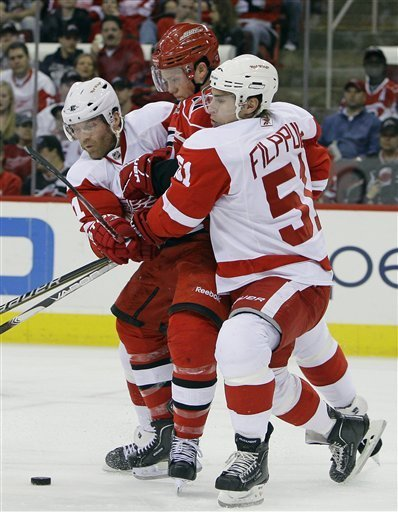 misswonderwall:  Skinner Sandwich!  Dan Cleary and Valtteri Filppula of the Detroit Red Wings and Jeff Skinner of the Carolina Hurricanes.