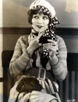 heyfool:  Clara Bow - c. 1920's  Everything about this picture of Clara makes me sigh in girlish delight. Her outfit is so cute, and she's like a gorgeous porcelain doll.