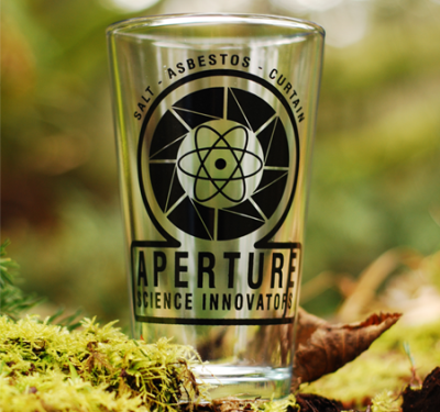 thedrunkenmoogle:  Aperture Science 1940s Logo Pint GlassSold in the Valve online store for $12.95 Note: If you drink lemonade from this pint glass, Cave Johnson will find you and burn your house down.  With LEMONS.  Oh shi—Don't do it guys! Don't ever try to drink lemonade in this glass. Cave Johnson probably patented a lemonade sensory system into the glass which would inevitably raise him from the grave and start a lemon bomb zombie apocalypse!