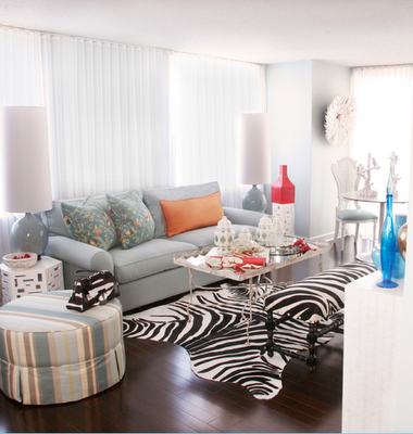 A living room filled with lots of fun accent pieces with lots of bright - white!