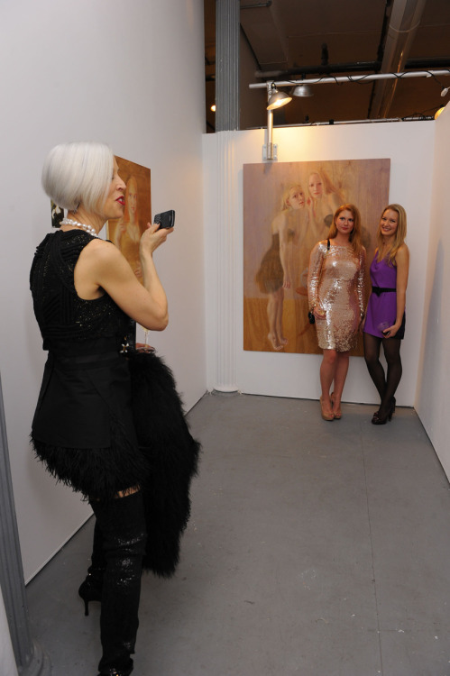 Linda Fargo taking a photo of me (Elina Anatole), my artwork, and my muse (Julie E. Brady).