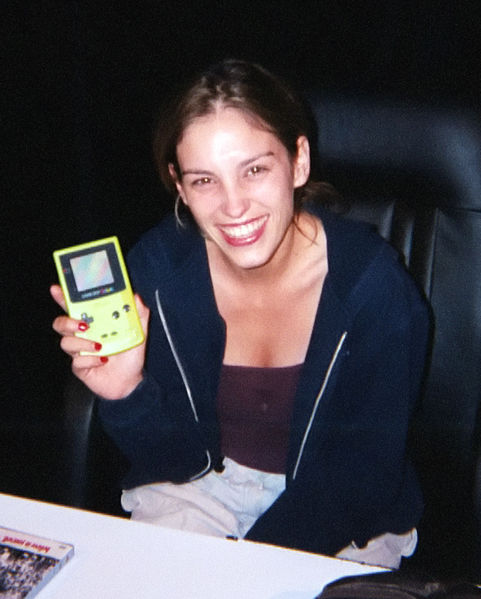 dontbejel:  the 90's, caught on film! Amy Jo Johnson shows off a neon green Gameboy!